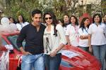 John Abraham and Prachi Desai at The 5th Lavasa Women's Drive Flag