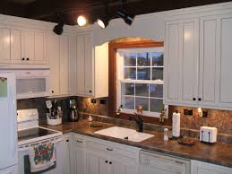 White Kitchen Cabinets With Black Granite Countertops by Antique White Kitchen Cabinets Cabinets Upholstered Chairs Wood