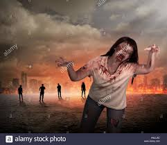 scary female zombie with burning city background halloween