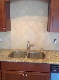 granite countertop southwest style cabinets tile backsplash
