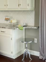 bianco antico granite countertop with white cabinets beveled