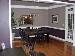 dining room on hardwood floors chair rail and crown moldings and