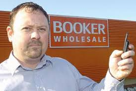 Simon Craven-Wall, whose home overlooks the Booker Wholesale company on ... - 48911