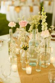 centerpieces assorted bottles and jars fall rustic backyard