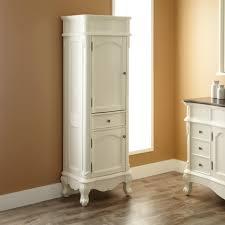 vintage style small corner bathroom storage cabinet on faux wood