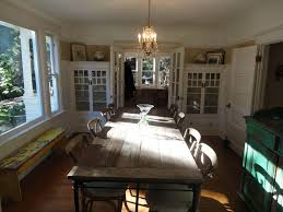 eclectic dining room with reclaimed wood bench u0026 crown molding in