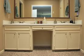 chrome handle bar on the top wooden vanity with storage shelves