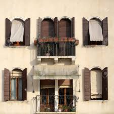 photo closeup of beige plastered facade of town house windows