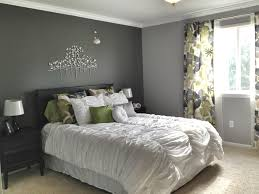 grey master bedroom dark accent wall fun patterned curtains