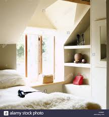 Loft Shelving by Hairdryer On Bed With Sheepskin Through In Modern Loft Style