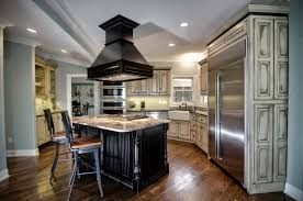kitchen cooker hoods kitchen with white cabinets and ductless