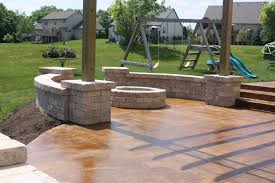 Backyard Cement Patio Ideas by Come Join Us Acid Stained Concrete Patio With Tumbled Stone Seat