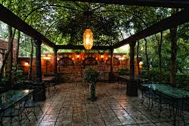 spanish courtyard design with metal pergola also iron dining sets