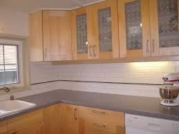kitchen with subway tile backsplash and oak cabinets google
