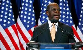 Herman Cain speaks at a press