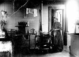 This is a picture of a woman cooking in her kitchen in the 1800s
