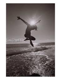 http://t2.gstatic.com/images?q=tbn:u_ZeuHYOoOoyqM:http://imagecache2.allposters.com/images/pic/PTGPOD/825041~Silhouette-Of-Dancer-Jumping-Over-Atlantic-Ocean-Posters.jpg&t=1