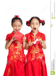 asian twins girls in chinese cheongsam dress with red envelope