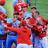Reds scrap with Cards at plate, tangle in outfield, win 9-6