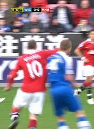 Rooney elbows McCarthy