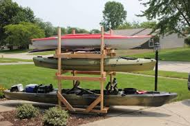 diy rolling kayak storage rack 2x4s and caster wheels paddle